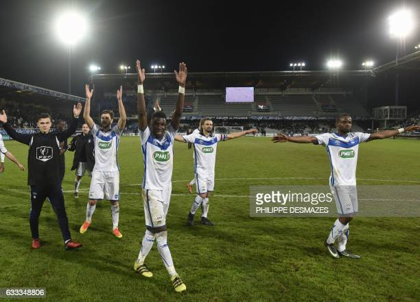 Auxerre's players jubilate at the end of the French Cup football match between AJ Auxerre and AS SaintEtienne on February 1 at the AbbeDeschamps...