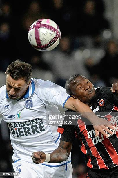 Auxerre's Polish midfielder Dariusz Dudka vies with Nice's Ivorian forward Franck Dja Djedje during the French L1 football match Auxerre vs Nice on...