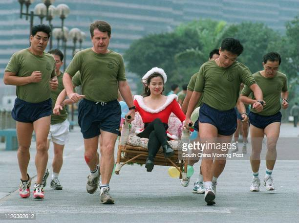 HK Auxiliary Police HQ personnel and training dept team in sedan chair race competition for Operation Santa Claus on 14 Dec 95
