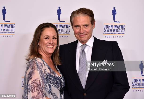 Auxiliary President Anita Swift and actor Michael Nouri attend John Wayne Cancer Institute Auxiliary's 32nd annual Odyssey Ball at the Beverly...