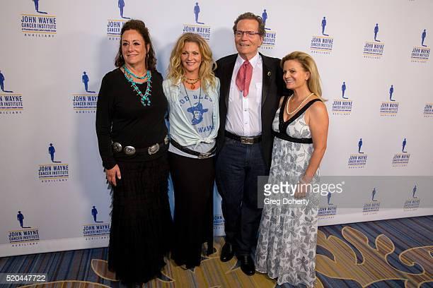 Auxiliary President of the John Wayne Cancer Institute Anita Swift Marissa Wayne Chairman Patrick Wayne and Melanie Wayne attend the John Wayne...