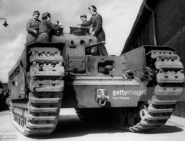 Auxiliary Territorial Services personnel sealing and preparing a Churchill tank for export to the Soviet Union.