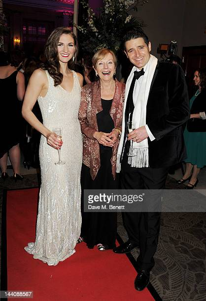 Ava Astaire McKenzie daughter of Fred Astaire poses with cast members Summer Strallen and Tom Chambers at an after party celebrating the press night...