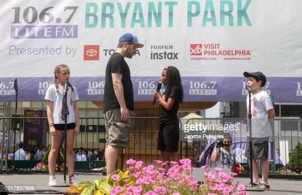 Ava Briglia Jonathan Wagner Layla Capers and Jordan Cole from the cast of 'School of Rock' perform at 1067 LITE FM's Broadway in Bryant Park August...