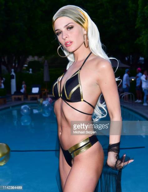 Ava Capra poses for portrait poolside at beGlammed Sunset Soiree Presented by Fullscreen on April 12 2019 in Palm Springs California