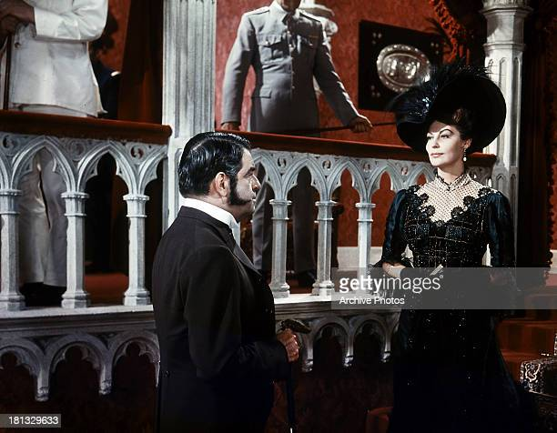 Ava Gardner is approached by a man in a scene from the film '55 Days At Peking' 1963