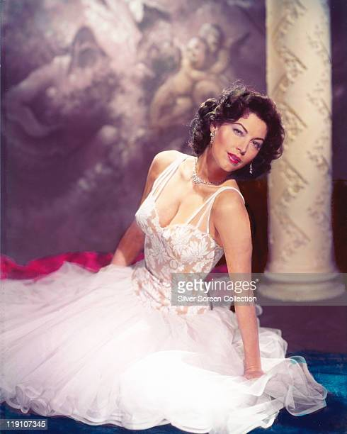 Ava Gardner US actress wearing a white dress with a lace bodice in a studio portrait circa 1955