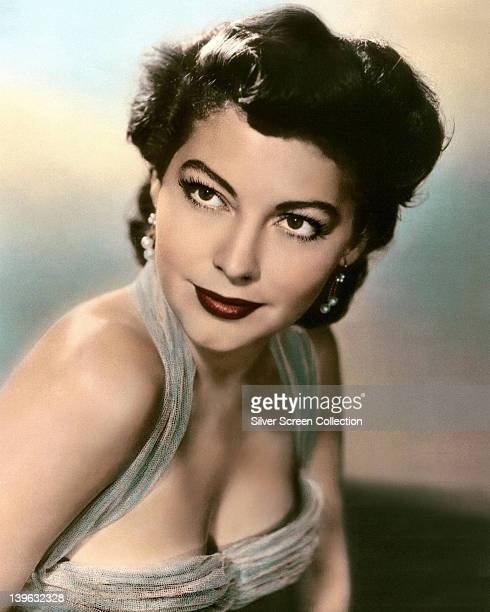 Ava Gardner US actress wearing halterneck dress with a scoop neckline in a studio portrait circa 1950