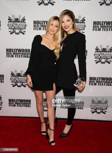 Ava Locklear and Maria Gabriela Cardenas arrive at A Dark Foe Film Premiere on February 15 2020 in Los Angeles California