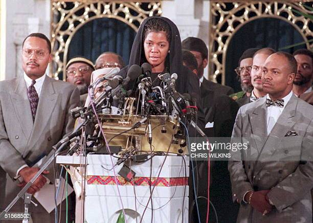 Ava Mohammad attorney for the Nation of Islam is flanked by group members 13 January as she speaks at a news conference in Chicago on the arrest of...
