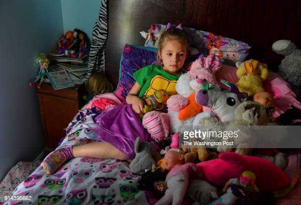 Ava Olsen who was on the playground during the Townville Elementary shooting poses for a picture with her stuffed animals on April 29 2017 in...