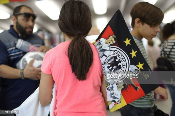 Ava Prego shops at the Soccer Locker store for German soccer team items as she prepares to show her support for her favorite World Cup soccer team...