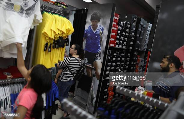 Ava Prego Telvia Prego and Rodrigo Prego shop at the Soccer Locker store for German soccer team items as they prepare to show their support for their...