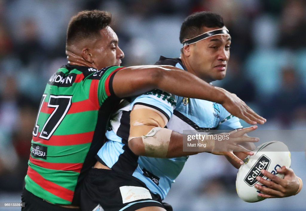 Ava Seumanufagai of the Sharks is tackled by Tevita Tatola of the Rabbitohs during the round 13 NRL match between the South Sydney Rabbitohs and the Cronulla Sharks at ANZ Stadium on June 1, 2018 in Sydney, Australia.