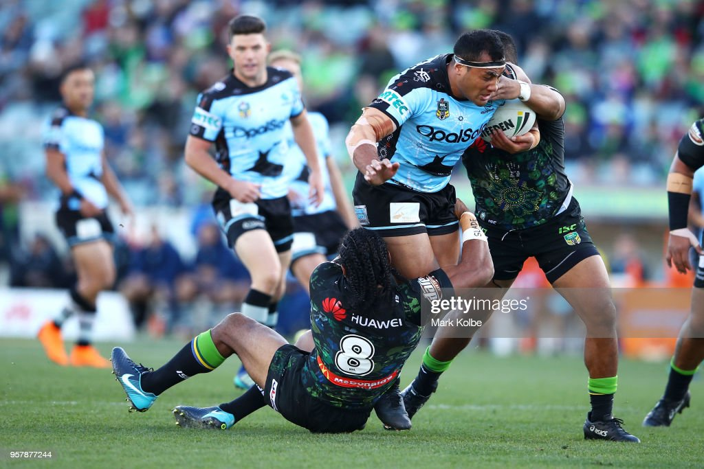 Ava Seumanufagai of the Sharks is tackled during the round 10 NRL match between the Canberra Raiders and the Cronulla Sharks at GIO Stadium on May 13, 2018 in Canberra, Australia.
