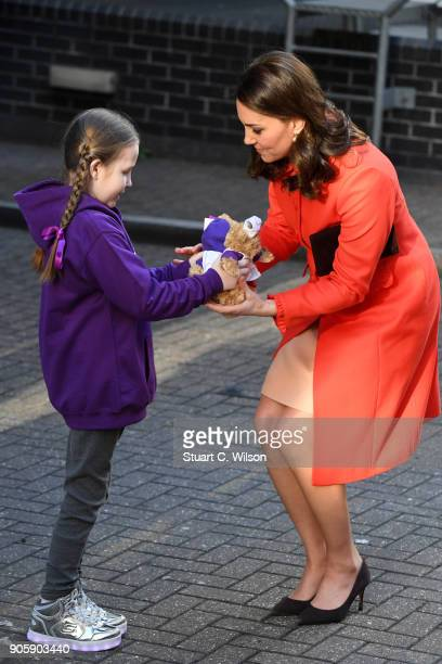 Ava Watt aged 9 with Cystic fibrosis presents Catherine Duchess of Cambridge with a gift during her visit to Great Ormond Street Hospital on January...