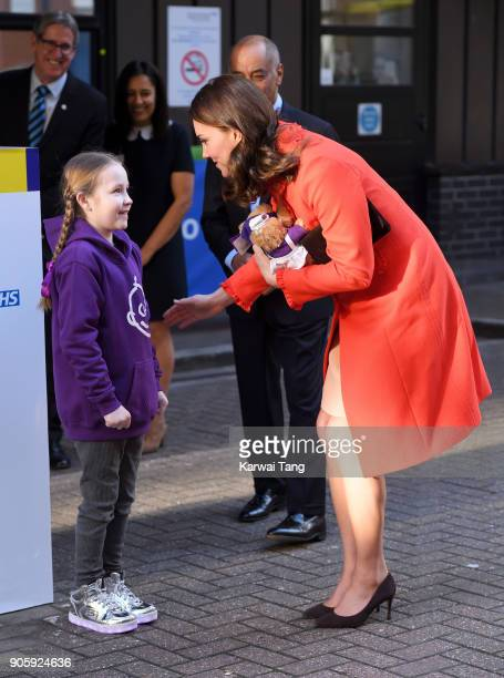 Ava Watt aged 9 with Cystic fibrosis presents Catherine Duchess of Cambridge with teddy bears during her visit to Great Ormond Street on January 17...