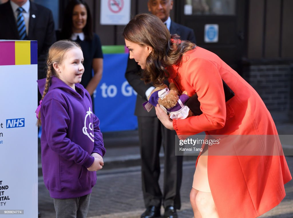 Ava Watt, aged 9 with Cystic fibrosis, presents Catherine, Duchess of Cambridge with teddy bears during her visit to Great Ormond Street on January 17, 2018 in London, England.