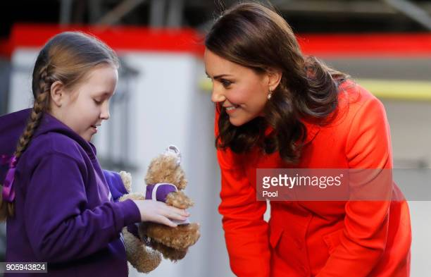 Ava Watt aged 9 with Cystic fibrosis presents Catherine Duchess of Cambridge with a gift as she arrives to officially open the Mittal Children's...