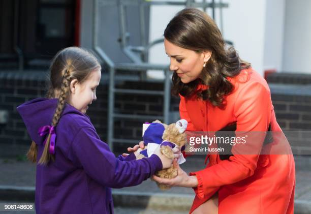 Ava Watt aged nine with cystic fibrosis presents Catherine Duchess of Cambridge with a gift as she visits Great Ormond Street Hospital on January 17...