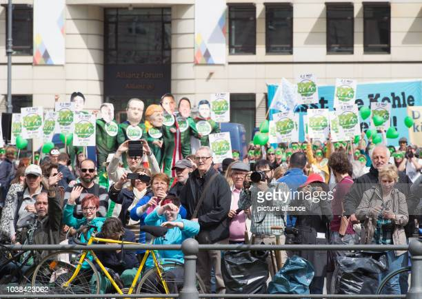 Avaaz activists and spectators watch the arrival of German Chancellor Angela Merkel to the 6th Petersberg Climate Dialogue conference in Berlin...