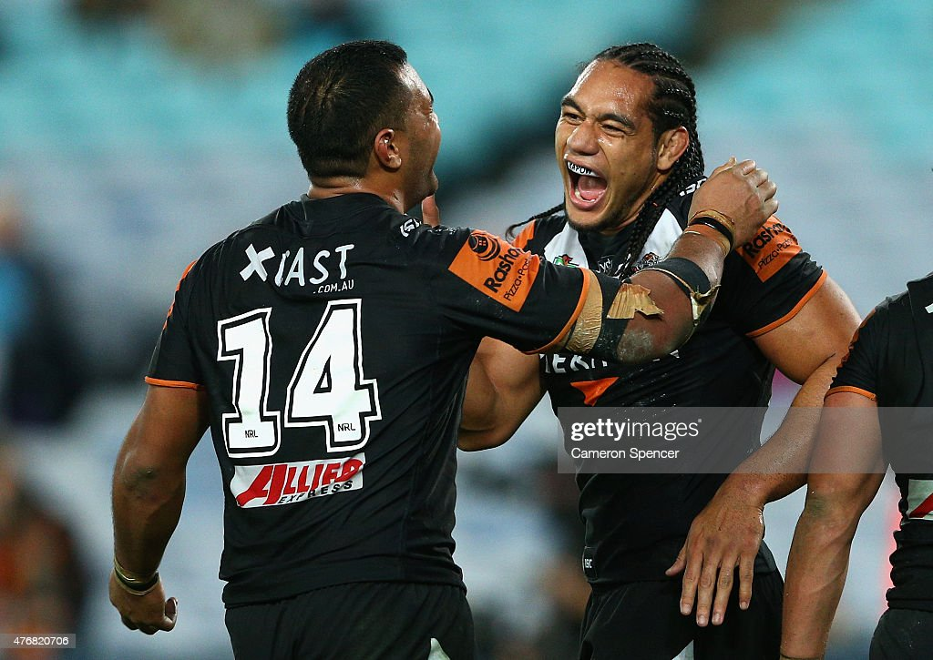 Avagalu Seumanfagai of the Tigers and Martin Taupau of the Tigers celebrate during the round 14 NRL match between the Wests Tigers and the South Sydney Rabbitohs at ANZ Stadium on June 12, 2015 in Sydney, Australia.