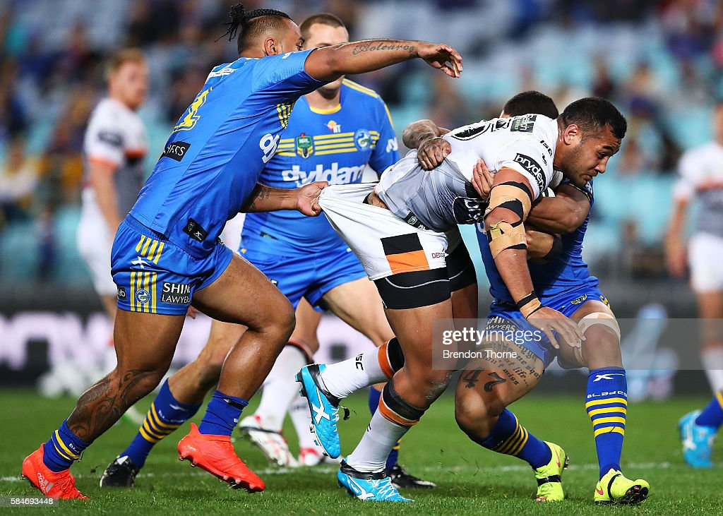 Avagalu Seumanufagai of the Tigers is tackled by the Eels defence during the round 21 NRL match between the Parramatta Eels and the Wests Tigers at ANZ Stadium on July 30, 2016 in Sydney, Australia.