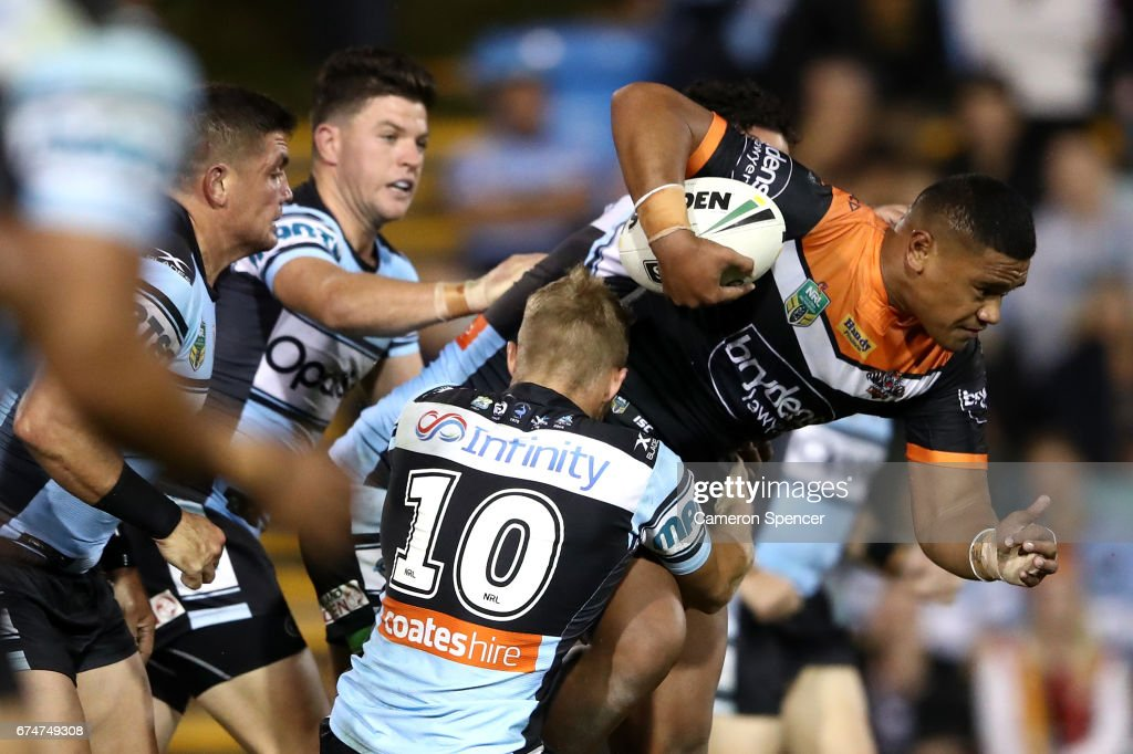 Avagalu Seumanufagai of the Tigers is tackled during the round nine NRL match between the Wests Tigers and the Cronulla Sharks at Leichhardt Oval on April 29, 2017 in Sydney, Australia.