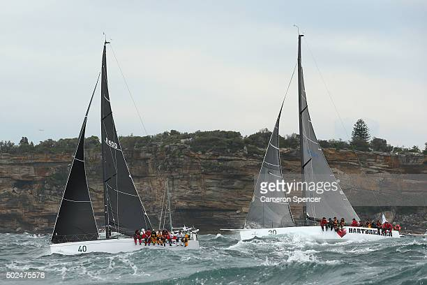 Avalanche and Hartbreaker race past the heads during the 2015 Sydney to Hobart on December 26 2015 in Sydney Australia