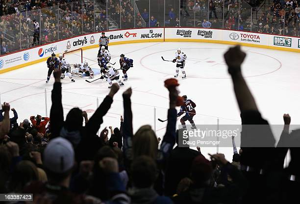 Avalanche fans celebrate a play by the Colorado Avalanche against the Chicago Blackhawks at the Pepsi Center on March 8 2013 in Denver Colorado The...