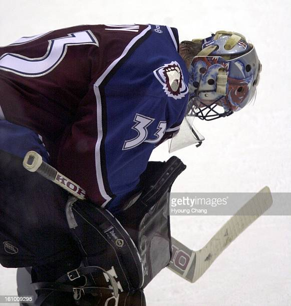 Avalanche goalie Patrick Roy looks to the ice after being scored on by Devils Petr Sykora late in the third period of game four of the Stanley Cup...