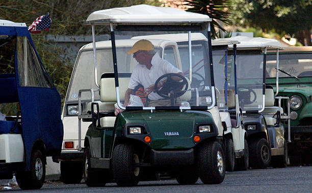 Avalon driver parallel parks his golf cart near the dock as he ... on golf car boat, shoes boat, golf carts pull type,