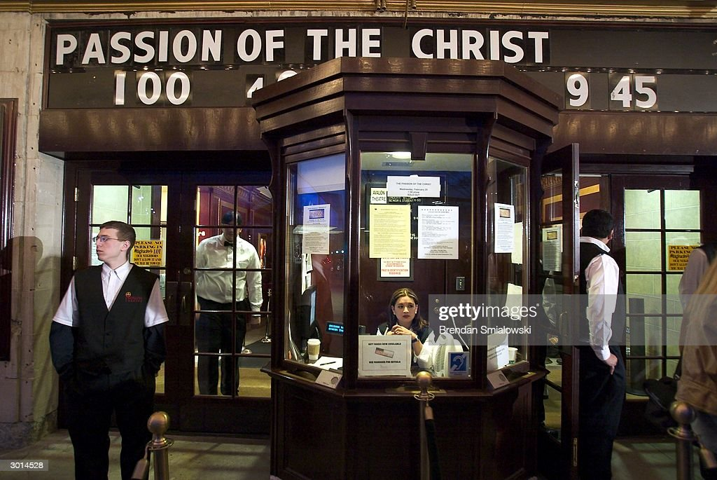 Avalon Theater personnel stand outside prior to the premiere of Mel Gibson's 'The Passion of the Christ' February 25, 2004 in Washington, DC.