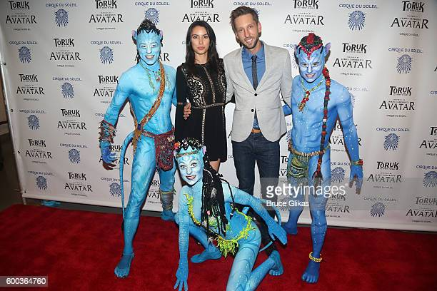 'Avatar' Film Star Joel David Moore and guest pose with 'Toruk' performers at the Opening Night for the New York Premeire of Cirque Du Soleil's...