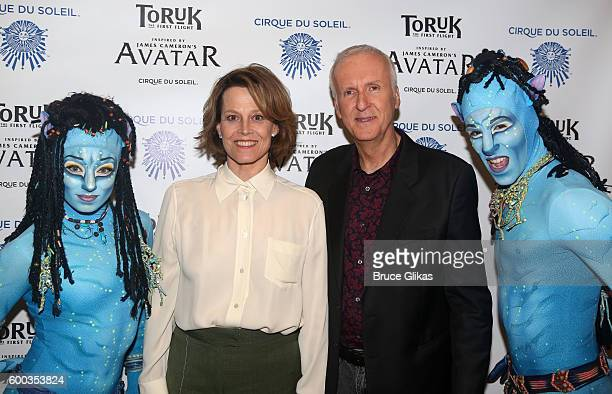 'Avatar' Film star Sigourney Weaver and Film Director James Cameron pose with performers at the Opening Night for the New York Premeire of Cirque Du...