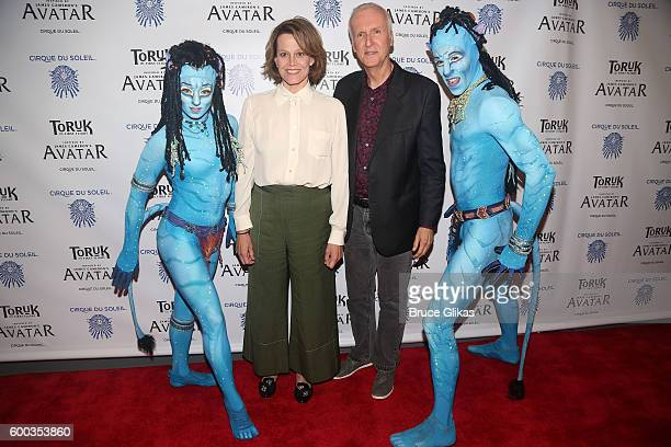 Avatar Film star Sigourney Weaver and Film Director James Cameron pose with performers at the Opening Night for the New York Premeire of Cirque Du...