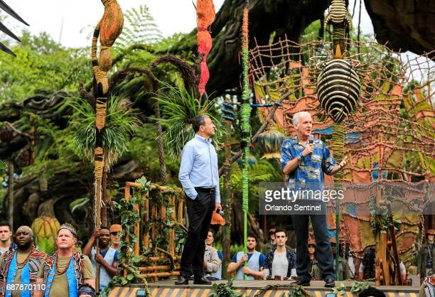 Avatar producer James Cameron right joins Disney Chairman and Chief Executive Officer Bob Iger at the 'Pandora The World of Avatar' dedication on...