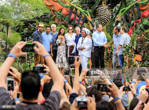 Avatar producer James Cameron third from left joins Disney Chairman and Chief Executive Officer Bob Iger third from right and actors from the movie...