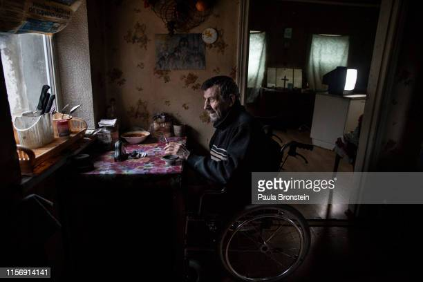 Vladimir Mamoshyn age 65 sits in his wheelchair his wife died in 2010 now he lives alone his children abandoned him He resides in the wartorn...
