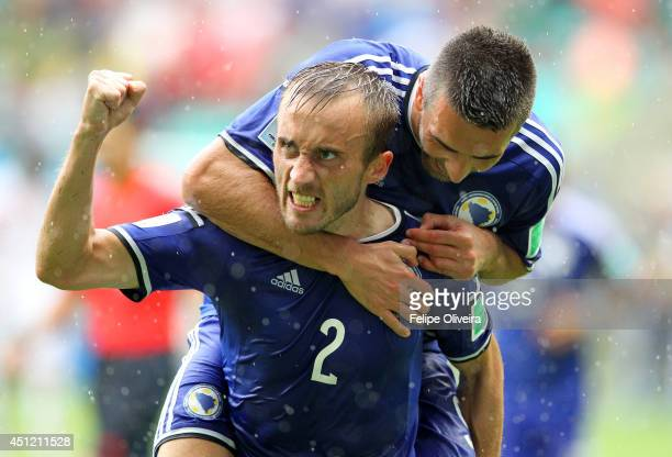 Avdija Vrsajevic of Bosnia and Herzegovina celebrates scoring his team's third goal during the 2014 FIFA World Cup Brazil Group F match between...