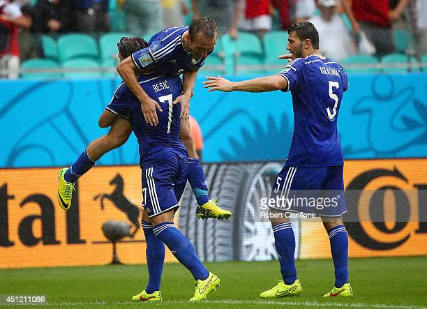 Avdija Vrsajevic of Bosnia and Herzegovina celebrates with teammates scoring his team's third goal during the 2014 FIFA World Cup Brazil Group F...