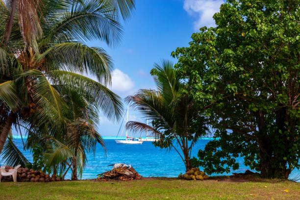 Avea Bay through the trees on the southern island of Huahine, (Huahine-Iti) French Polynesia