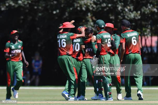 Aveet Desai of Kenya is congratulated by team mates after dismissing Bhaskar Yadram of the West Indies during the ICC U19 Cricket World Cup match...