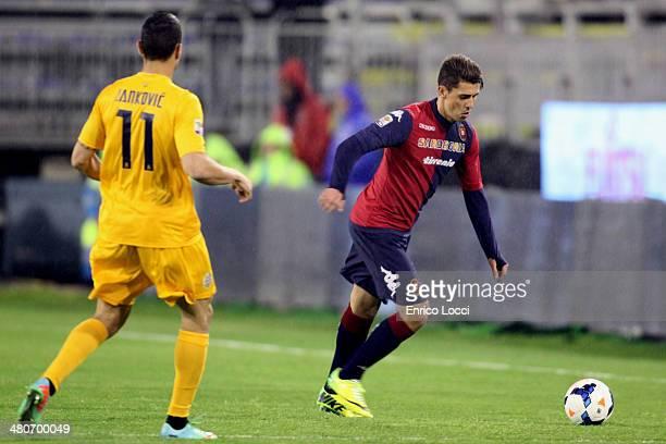 Avelar Danilo of Cagliari competes for the ball with Jankovic Bosko of Verona during the Serie A match between Cagliari Calcio and Hellas Verona FC...