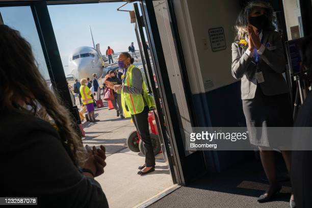 Avelo Airlines employees greet arriving passengers disembarking from a Boeing Co. 737-800 jetliner operated by Avelo Airlines at Hollywood Burbank...