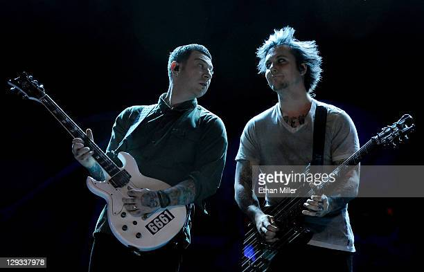 Avenged Sevenfold guitarists Synyster Gates and Zacky Vengeance perform during the 48 Hours Festival October 15 2011 in Las Vegas Nevada