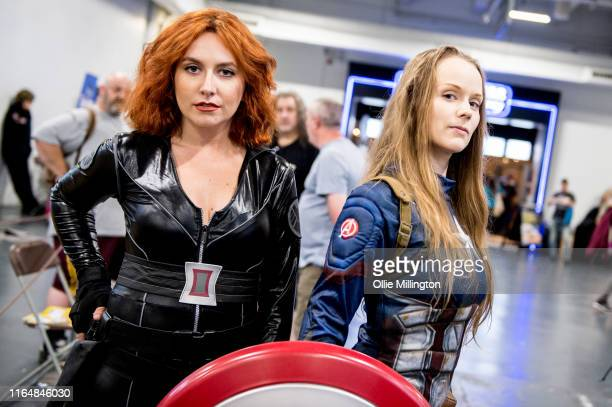 Avengers cosplayers in character as Black Widow and Captain America seen during London Film and Comic Con 2019 at Olympia London on July 27 2019 in...