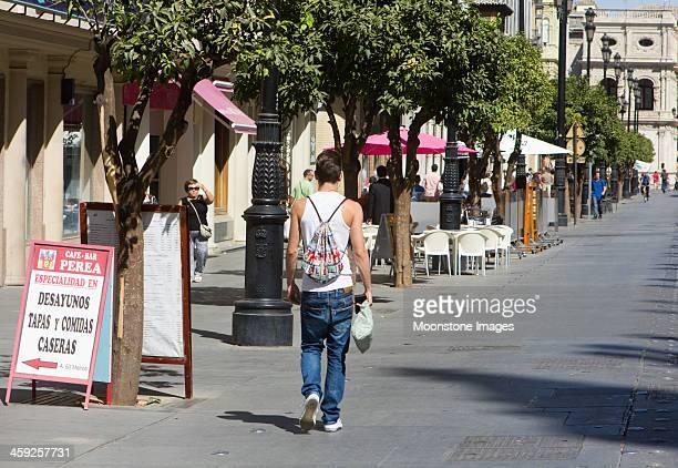avenida de la constitución in seville, spain - baggy jeans stock photos and pictures