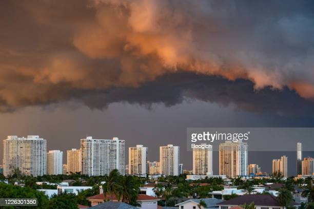 aventura high rise buildings with dark sky - hurricane stock pictures, royalty-free photos & images