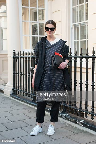 Avenue 32 creative director Romilly Mason wears a Dries Van Noten jacket and trousers Litkovskaya dress Celine bag and sunglasses and Adidas trainers...
